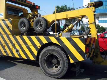 Tow truck providing emergency roadside assistance